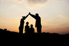Silhouette, group of happy family royalty free stock images