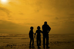 Silhouette group of kids playing at the beach Stock Image