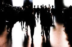 Silhouette of a group of models in movement. Silhouette of a group of models with a movement effect at the end of the catwalk during Cibeles Fashion Week Autumn Royalty Free Stock Photos