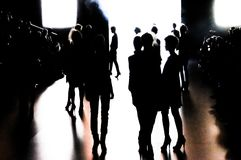 Silhouette of a group of models in movement. Silhouette of a group of models with a movement effect at the end of the catwalk during  Cibeles Fashion Week Autumn Stock Image