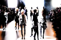 Silhouette of a group of models in movement. Silhouette of a group of models with a slight movement effect at the end of the catwalk during  Cibeles Fashion Week Royalty Free Stock Photos