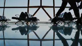 Silhouette group of passenger walking with luggage at airport. Silhouette group of passenger walking with luggage at airport stock footage