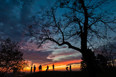 Silhouette of a group of people at colorful sunset over Kalemegdan park in Belgrade. Serbia Stock Photo