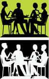 Silhouette of a group of people sitting at a table Royalty Free Stock Image