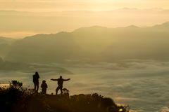 Silhouette of group people standing. On the mountain and take photos at sunrise., at Doi Luang Chiang Dao Chiang Mai Thailand, silhouette concept Royalty Free Stock Photos