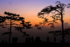 Silhouette group of people standing in sunset. On the mountain for take a photo Stock Photography