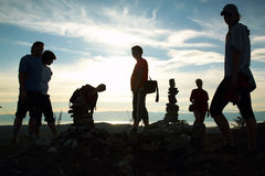 Silhouette of group of people at top of mountain royalty free stock photography