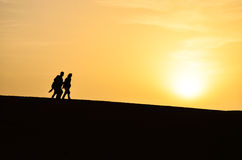 Silhouette of a Group of People Walking During Sunrise Royalty Free Stock Photography