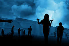 Silhouette group of zombie walking under full moon Royalty Free Stock Image
