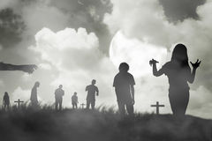 Silhouette group of zombie walking under full moon. Halloween concept Royalty Free Stock Photography
