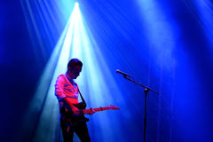 Silhouette of the guitar player of We Cut Corners (band) live performance at Bime Festival Royalty Free Stock Images