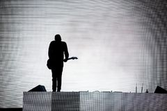 Silhouette of a guitar player royalty free stock photos