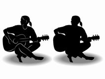 Silhouette of a guitar player. vector drawing Stock Photos