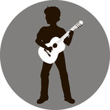 Silhouette of guitarist Stock Images