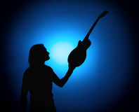 Silhouette guitarists of a rock band with guitar on blue background Royalty Free Stock Photo