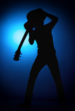 Silhouette guitarists of a rock band with guitar on blue background Royalty Free Stock Images