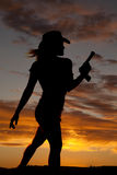 Silhouette gun woman walk Stock Photography