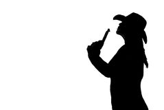 Silhouette gunfighting woman. Black and white silhouette of a woman blowing off the end of her gun as if she just shot Royalty Free Stock Photo