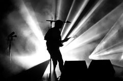 Silhouette of a Guy playing a Guitar. A silhouette of a guy playing a guitar Royalty Free Stock Photo