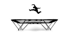 Silhouette of gymnast on trampoline Royalty Free Stock Photography
