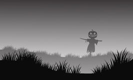 Silhouette of halloween scarecrow in fields Stock Photo