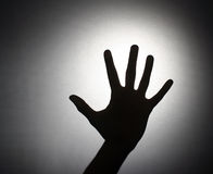 Silhouette of a hand Stock Photography