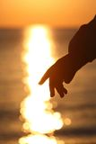 Silhouette of hand of child stock image