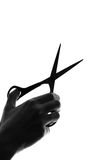 Silhouette hand with cutting scissors Stock Image