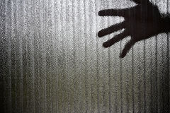 Silhouette of a hand the expression to be imprisoned Stock Photography