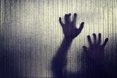 Silhouette of a hand the expression to be imprisoned, blur Stock Photos