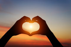 Silhouette hand gesture feeling love during sunset Royalty Free Stock Image