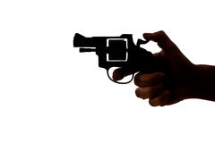 Silhouette of a hand with a handgun Royalty Free Stock Photo