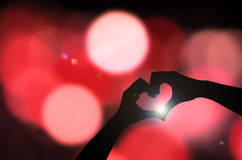 Silhouette hand in heart Royalty Free Stock Photo
