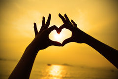 Silhouette hand in heart shape Royalty Free Stock Photo