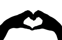 Silhouette hand in heart shape Royalty Free Stock Photos