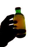 Silhouette of hand holding bottle of larger. Cutout Stock Images