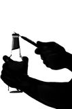 Silhouette of a hand holding and opening beer Royalty Free Stock Images