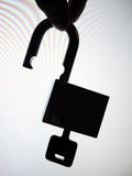 Silhouette hand picking up the unlock padlock Royalty Free Stock Photo