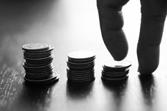silhouette of hand walkin on stacked of money coins Royalty Free Stock Photography