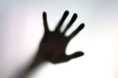 Silhouette of hand on a white surface Royalty Free Stock Images