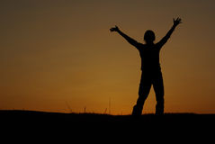 Silhouette hands in air Stock Photography