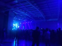 Silhouette hands of audience crowd people use smart phones enjoying the club party with concert. stock photography