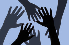 Silhouette of Hands with Deep Blue Filtered. Stock Image