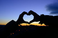 Silhouette of hands in form of heart Royalty Free Stock Photo