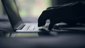 Silhouette of hands on the keyboard MacBook. Fingers typing text. Video has dubbed sound stock video