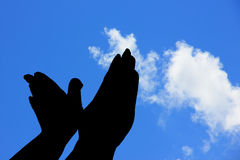 Silhouette of hands like bird under blue sky Royalty Free Stock Image