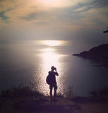 Silhouette of happiness traveler take a photo Stock Photos