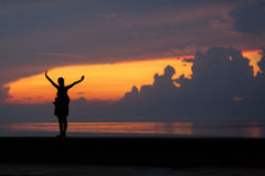 Silhouette of Happiness woman stay outdoor under sunlight of sun Royalty Free Stock Photos