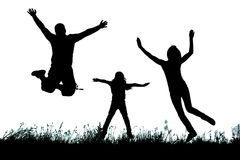 Silhouette of a happy active family jumping Stock Photos