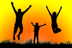 Silhouette of a happy active family jumping at sunset Royalty Free Stock Image